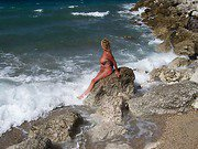 Sexy wife sun baths naked on the beach in the sun
