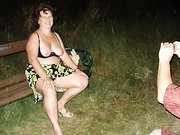 Mature brunette loves to pose outside showing her tits