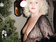 Blonde wife dresses in her santa hat and sexy fishnet stockings