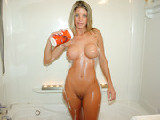 Beautiful blue eyed blonde with big tits naked in the shower