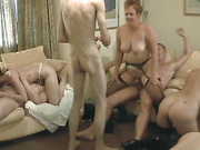 Swinger slut wives gangbanged and eating pussy